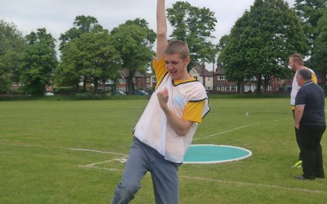A student at the Natspec Games 2018 sporting event in Doncaster punching the air after a successful round in the athletics activity