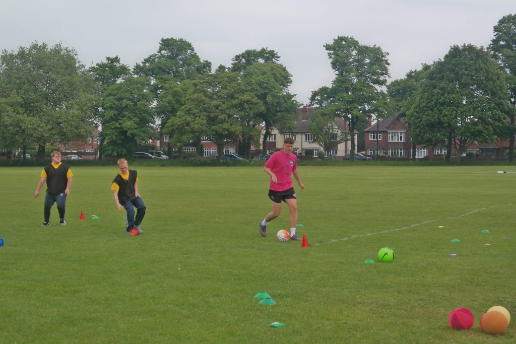 Students playing football at the Doncaster games.