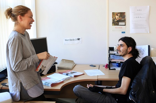 student on work experience talking to a colleague