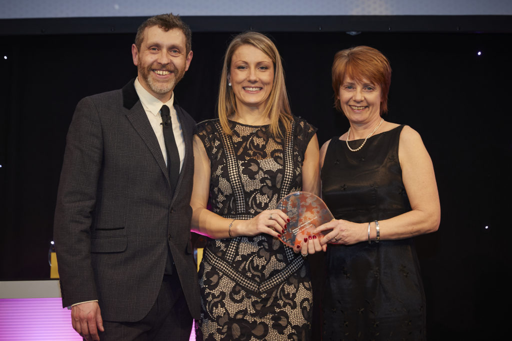 National Star collects award from host Dave Gorman and Natspec's Clare Howard
