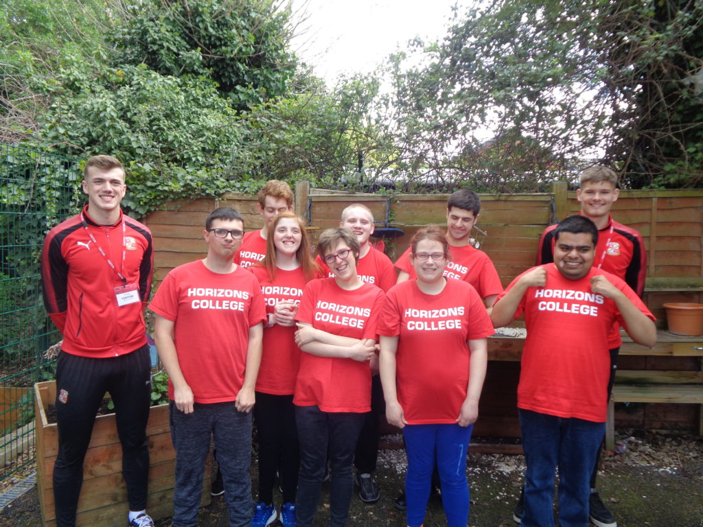 Horizons College students pictured standing with Swindon Town FC youth players