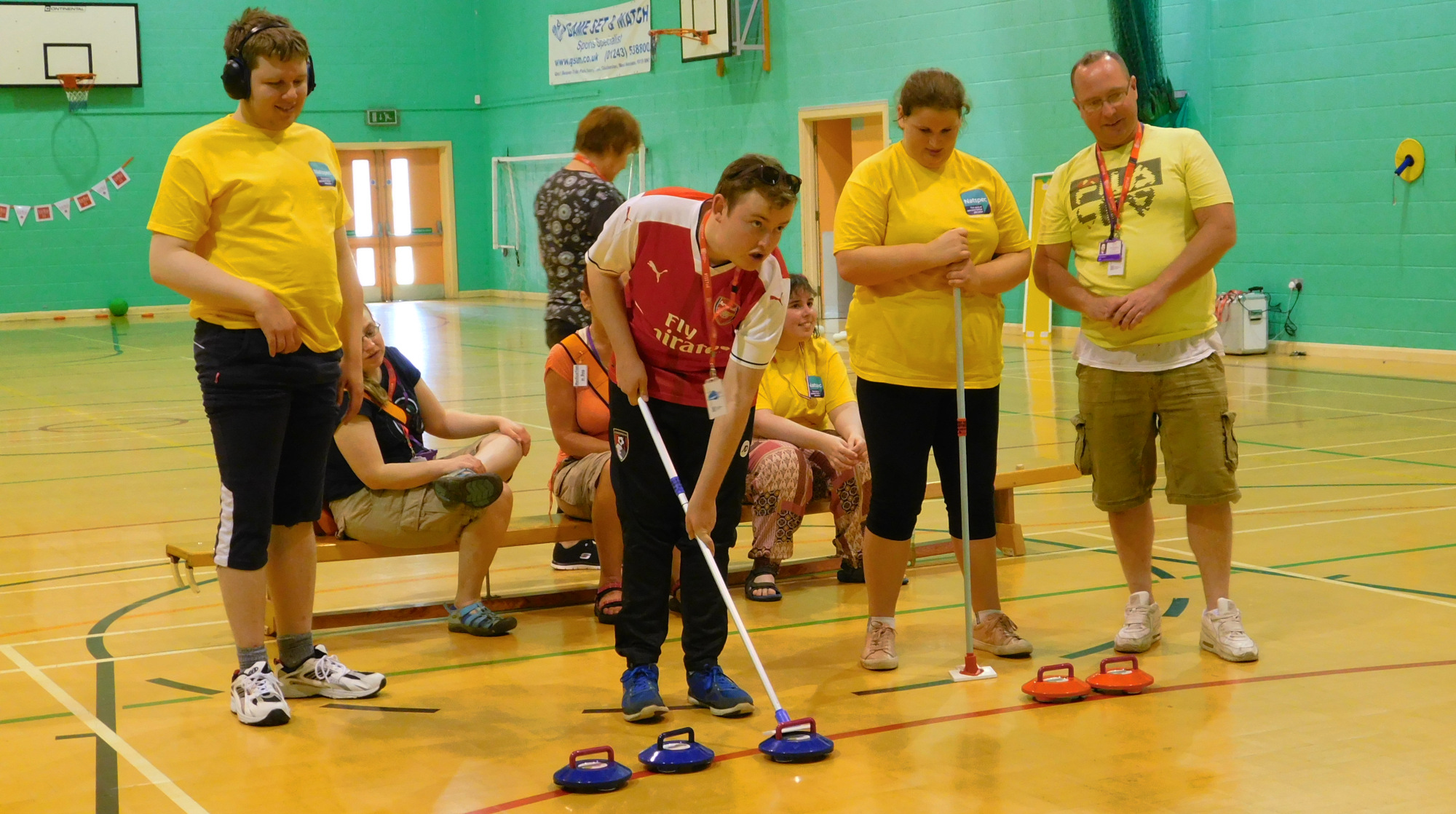 student engages in a shuffleboard type game at the Natspec Games