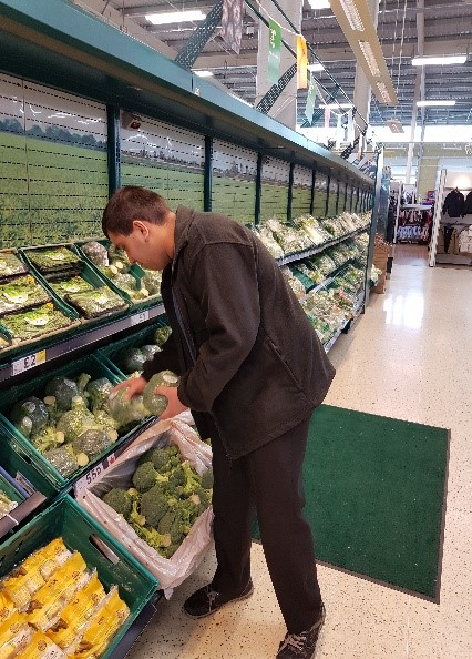 Student from The Hive College on work placement in supermarket