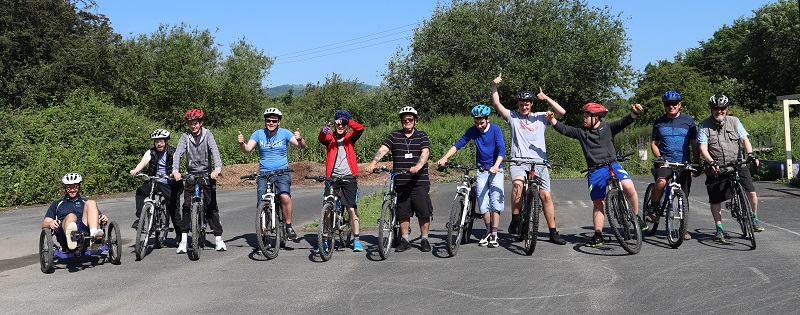 A large group of students with their bicycles