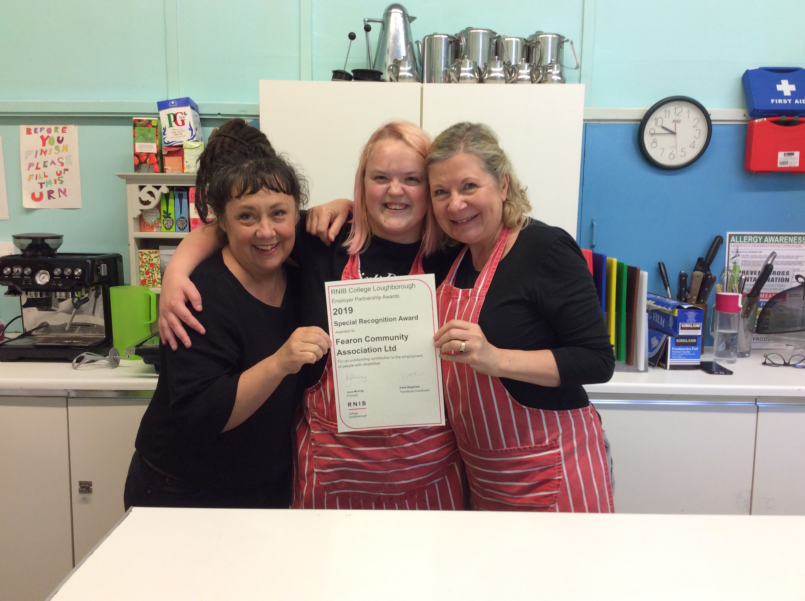 Staff at Fearon celebrate being awarded their certificate