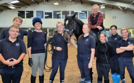 Martin Clunes (on horseback) with learners from FCRT