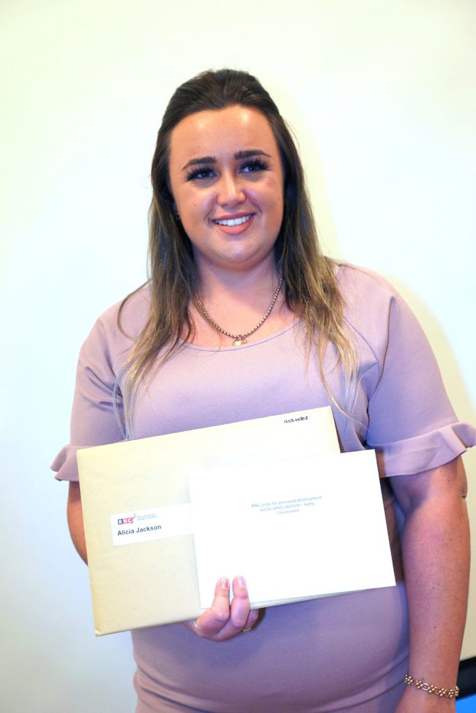 Alicia holds her exam results envelope