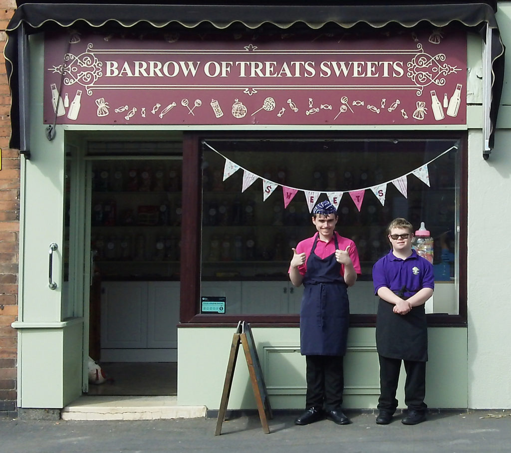 Students Ashley & Sean outside newly refurbished Barrow of Treats sweetshop