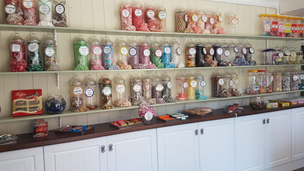Traditional sweetshop style cabinets inside Barrow of Treats sweetshop