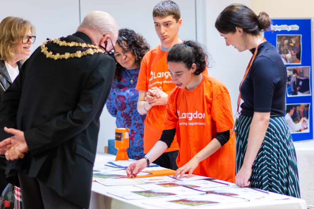 Langdon students show the new calendars to the Mayor of Bury