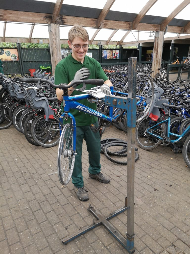 Brodie working on maintaining a bike at centre parcs