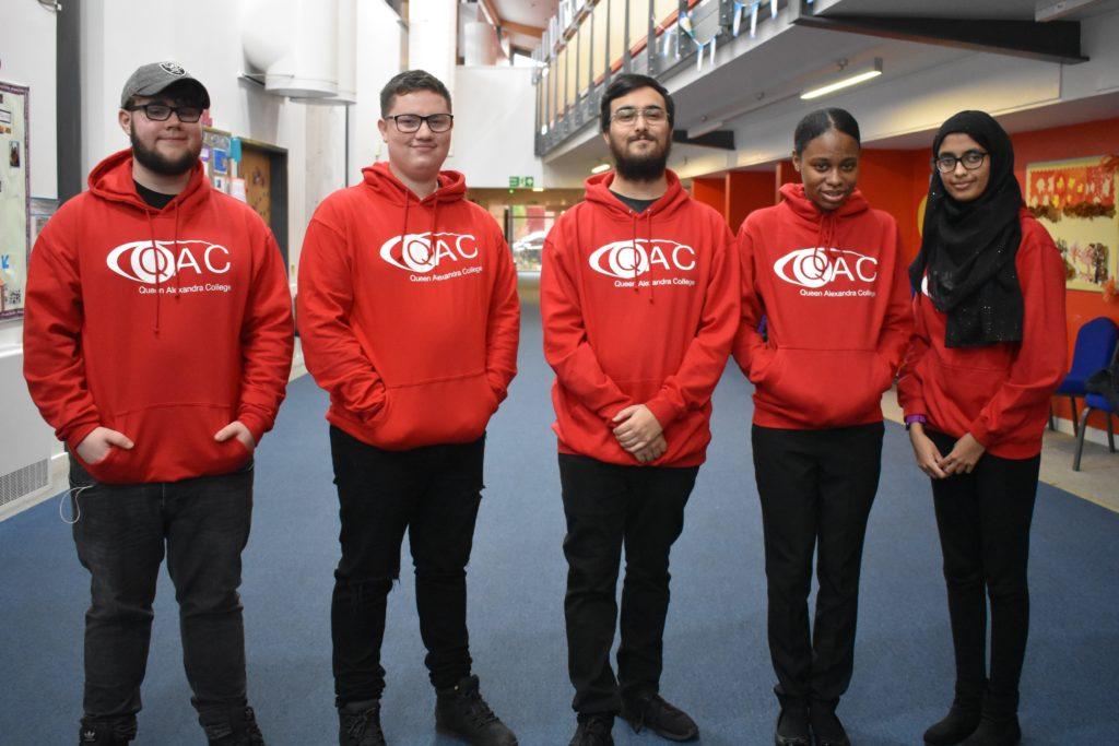QAC's new student ambassadors in red QAC hoodies