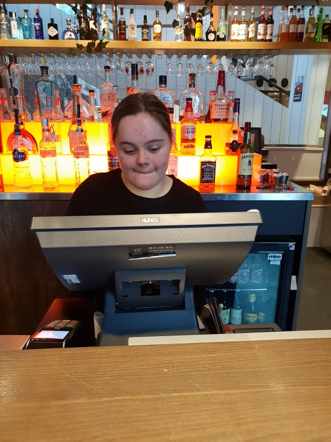 Emily works the till behind the bar
