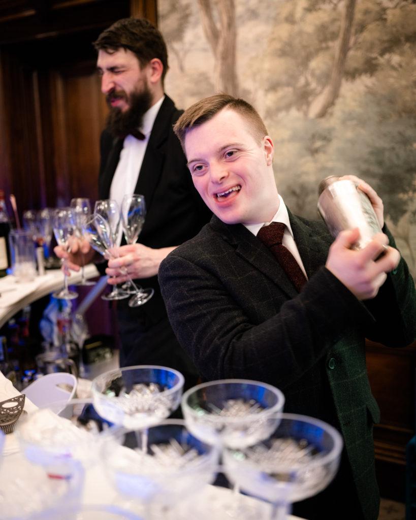 Tom makes cocktails behind the bar