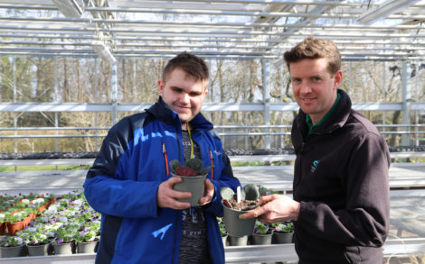 A learner and tutor show off their planting skills for careers week