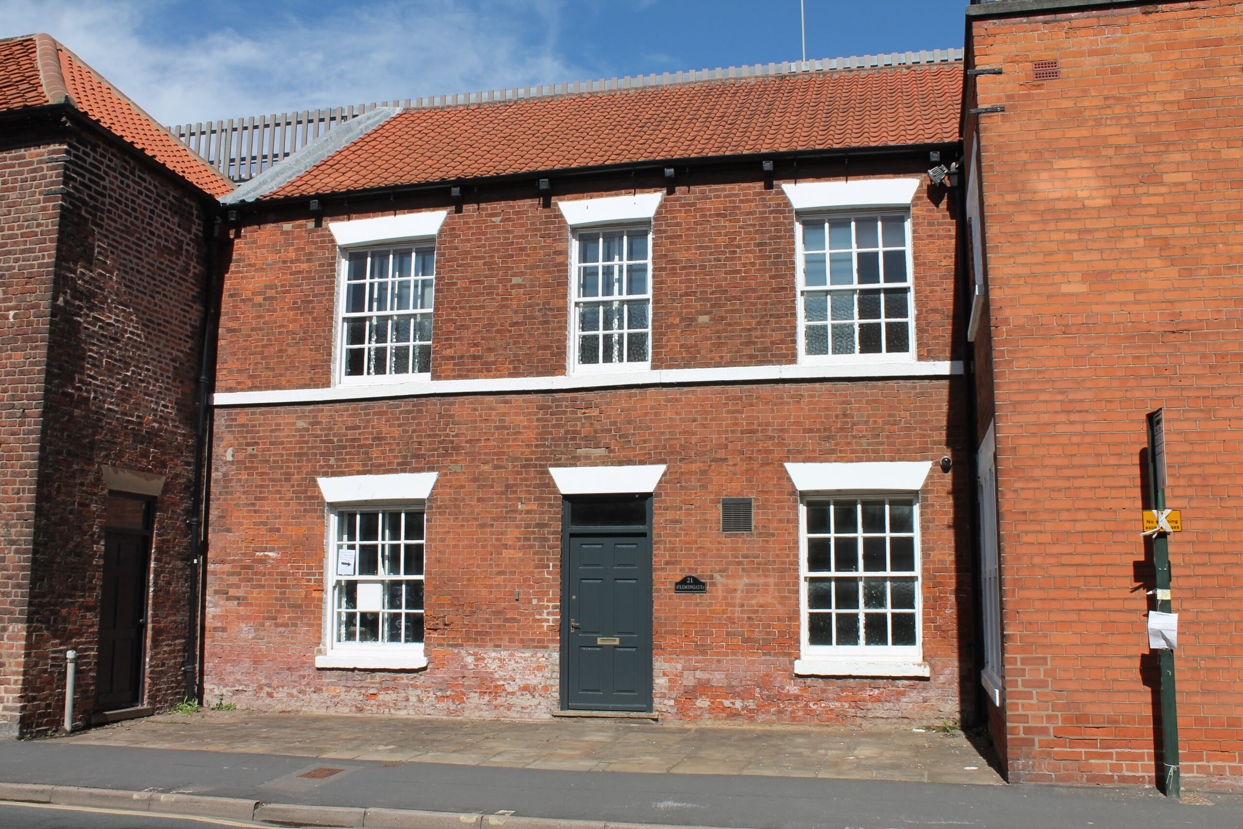 The outside of a brick building with georgian style windows, Linkage College's new campus