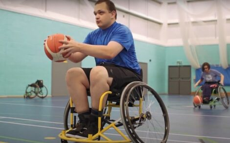 A student in a wheelchair holding a basketball