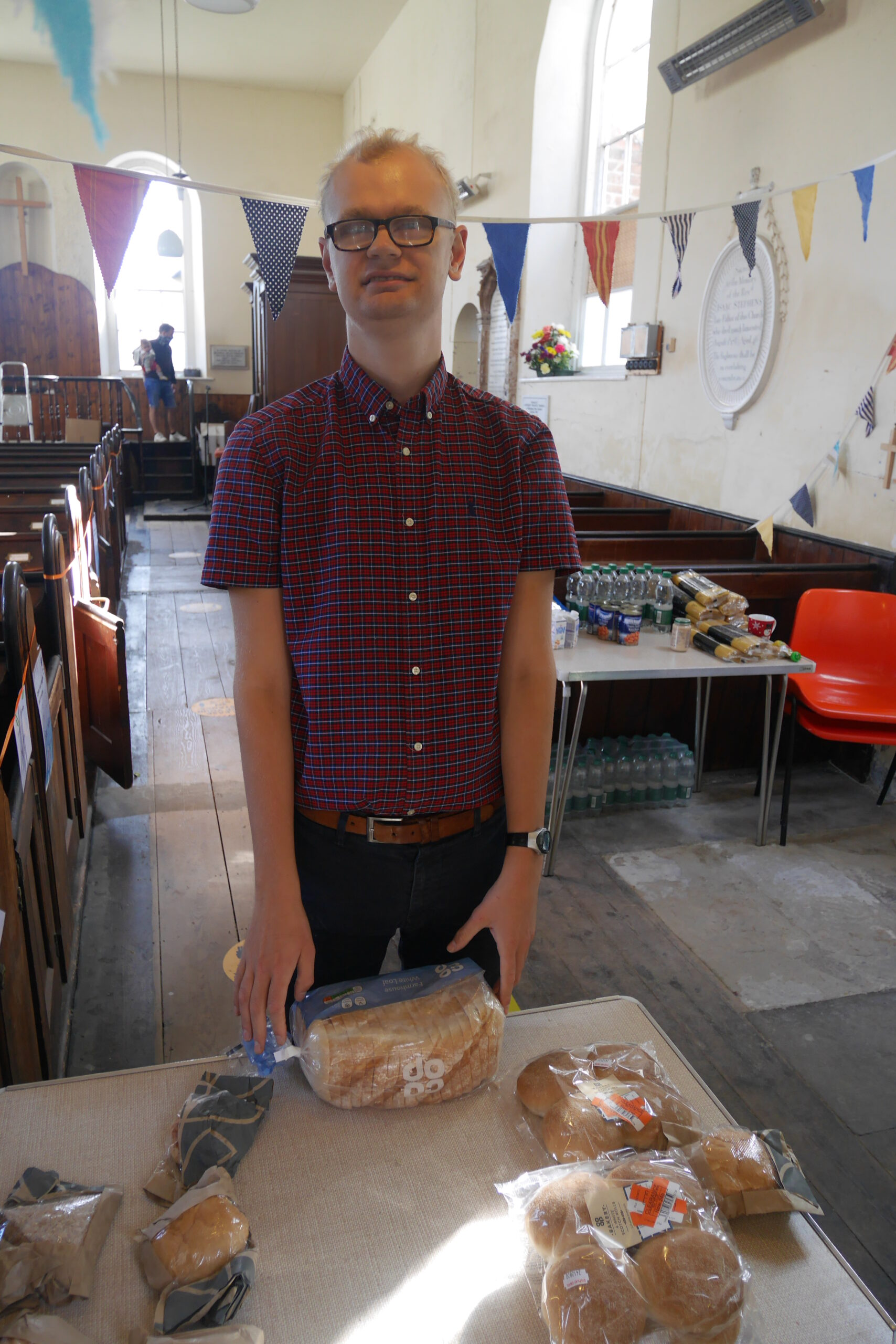 Max, helping sort food whilst working at Upton Baptist Church
