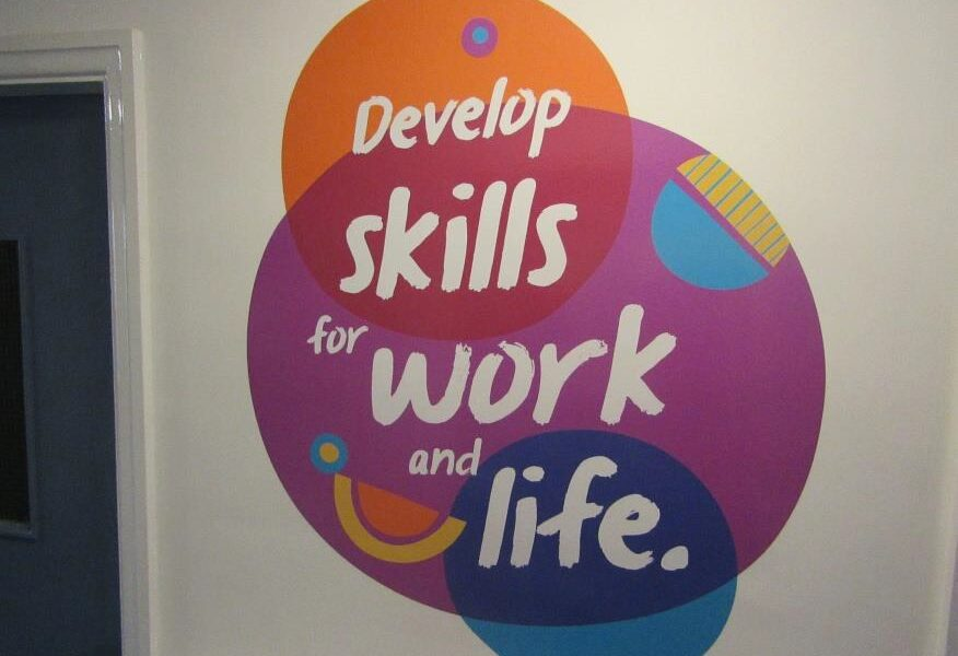 a colourful mural on a wall which reads 'develop skills for work and life'