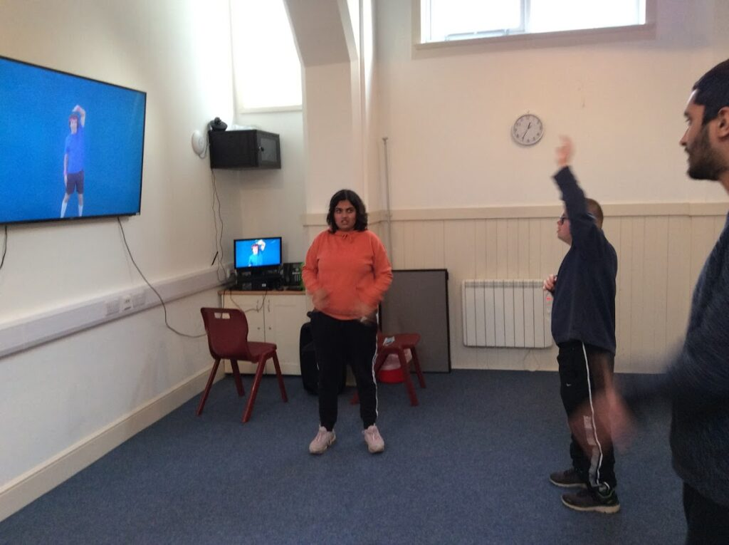 A student takes part in a virtual exercise class
