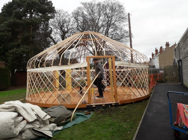 A yurt in the process of being constructed. It is currently a circular wooden frame