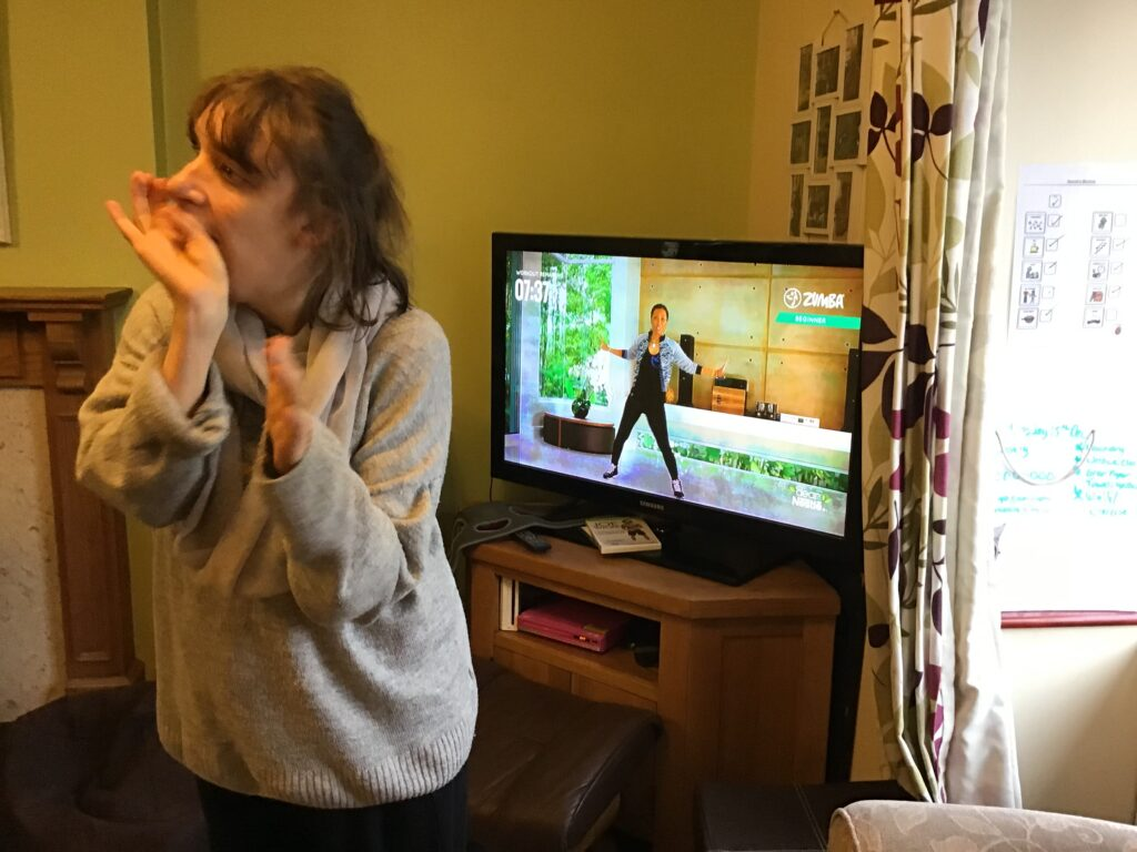 a student at condover college taking part in a virtual zumba session