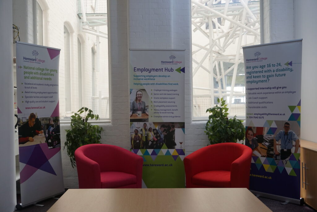 the inside of Hereward college's new base, featuring comfortable seating and promotional banners