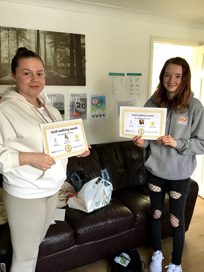 two students with their gold walking awards