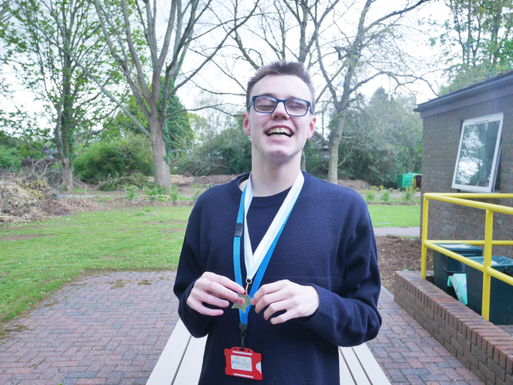 Ioan, smiling, with his winner's medal in hand
