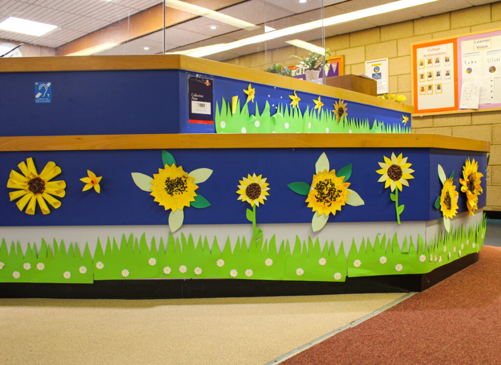 the reception at sense college loughborough decorated with a field of sunflowers