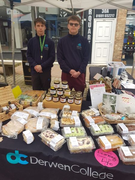 Students Brandon and Dougie at the Derwen College market stall, which offers an enticing range of bread, cakes, jam and other products
