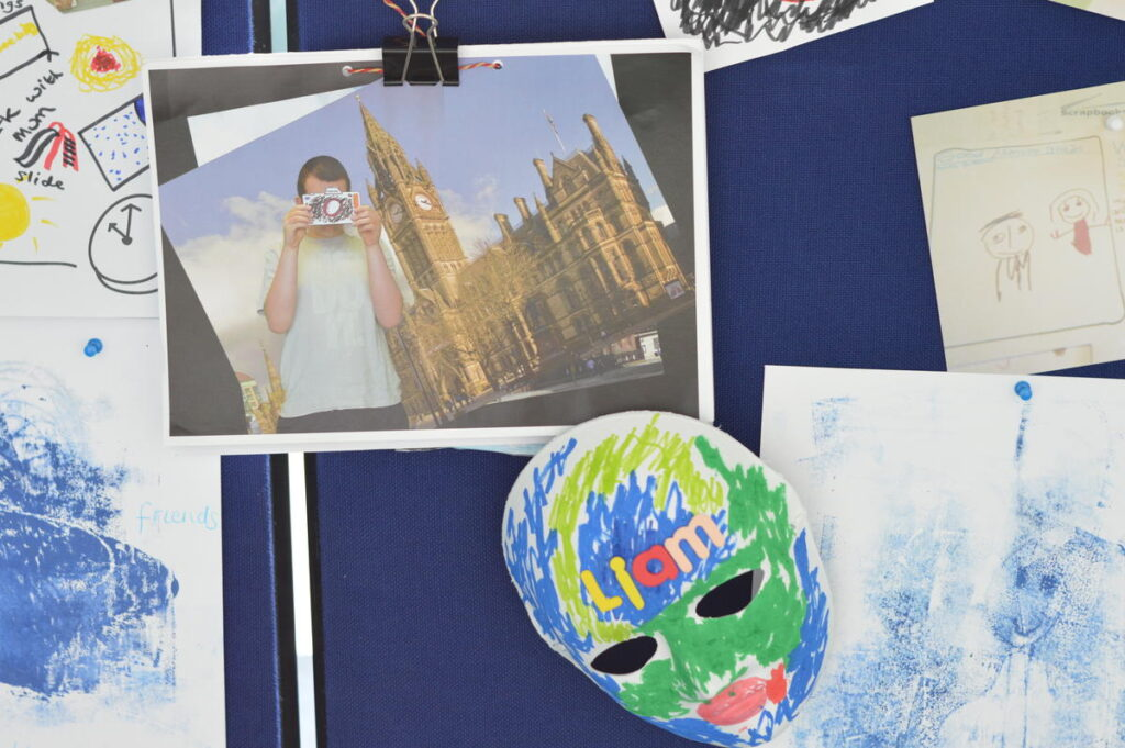 Artwork from students from Bridge College. It includes a photographic collage of a student outside the houses of parliament and a colourful mask