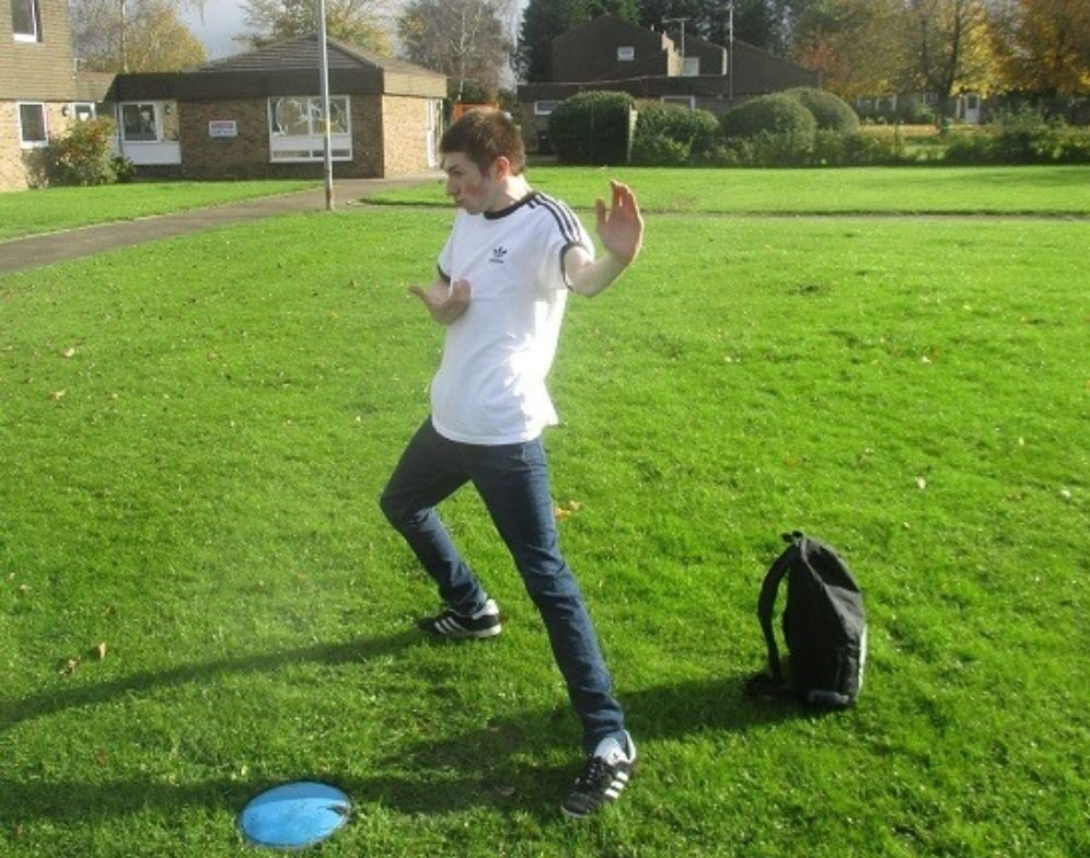 Liam in a grassy field leading a kung-fu session